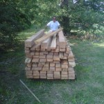 Robert Royal and the stack of pecan lumber - Summer 2011