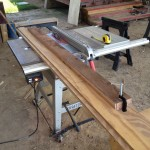 Jig used to cut straight edge on 2x4's with tablesaw