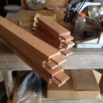 Tenons cut for stretchers to connect legs on table base