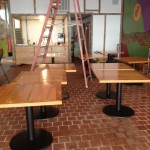 Tables delivered and attached to metal bases